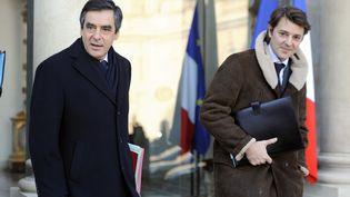 François Fillon, alors premier ministre, et François Baroin, alors ministre de l'Economie, le 4 janvier 2012, à l'Elysée. (ERIC FEFERBERG / AFP)