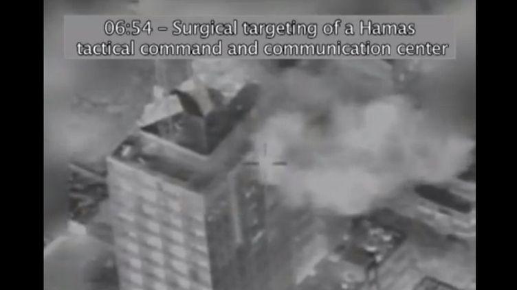 """Capture d'écran d'une vidéo présentant une """"frappe chirurgicale"""" contre un bâtiment gazaoui, le 18 novembre 2012 et transmise par les Forces de défense israéliennes. (ISRAEL DEFENSE FORCES)"""