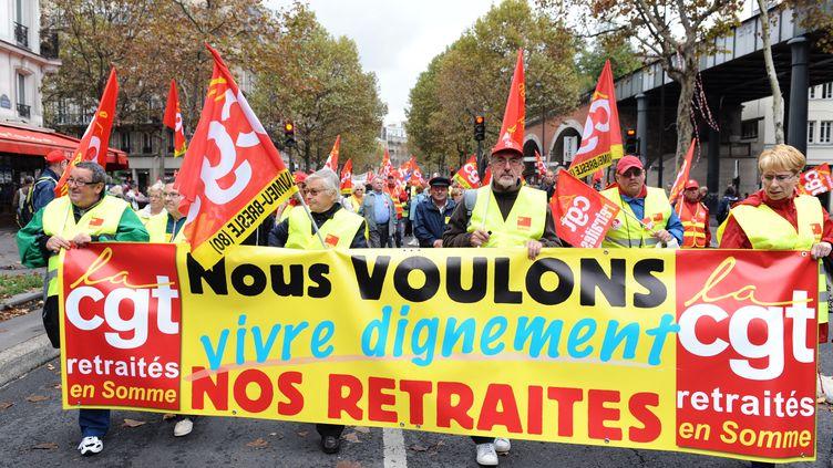 Des manifestants de la CGT lors des manifestations, le 6 octobre 2011. (MIGUEL MEDINA / AFP)
