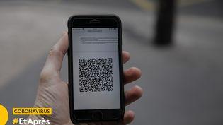 QR Code sur un smartphone (illustration) (YANN CASTANIER/HANS LUCAS/AFP)