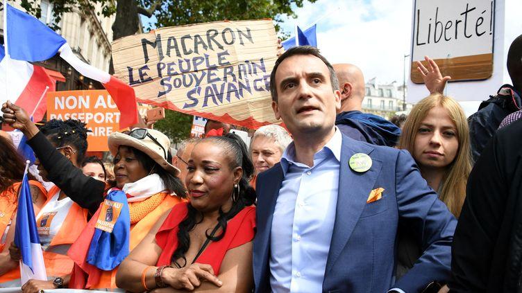 Florian Philippot dans une manifestation anti-pass sanitaire, à Paris, le 31 juillet 2021. (BERTRAND GUAY / AFP)