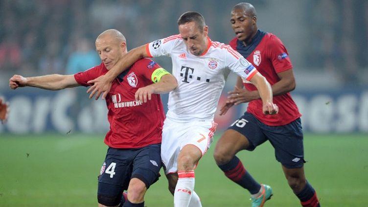 A l'image de Franck Ribéry qui barre Florent Balmont, le Bayern a facilement dominé Lille