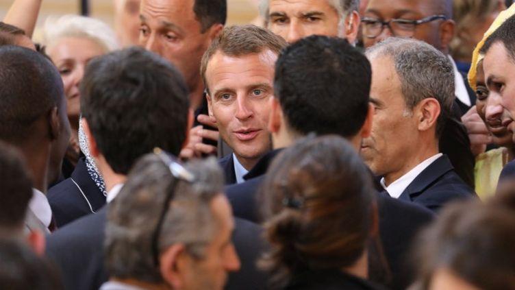 Emmanuel Macron, le 22 mai 2018, après la présentation d'unesérie de mesures pour les quartiers défavorisés s'inspirant, en partie seulement, du rapport remis par Jean-Louis Borloo. (LUDOVIC MARIN / POOL)