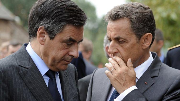 François Fillon et Nicolas Sarkozy, le 28 juin 2011 à Sablé-sur-Sarthe (Sarthe). (ERIC FEFERBERG / AFP)