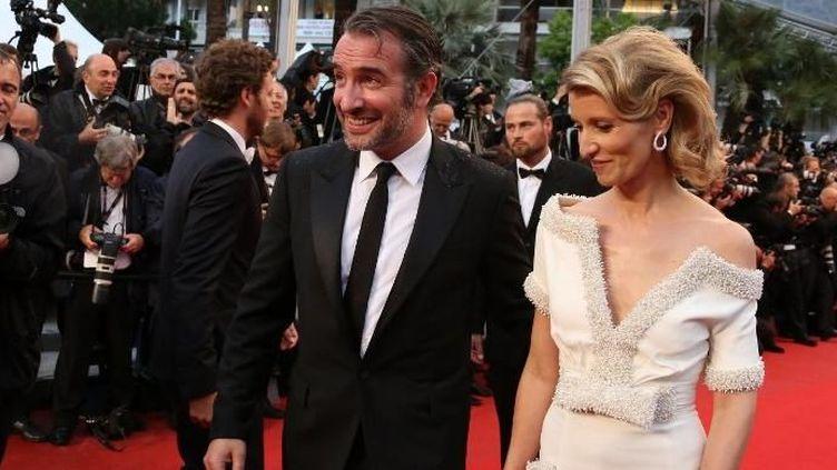 Jean Dujardin et Alexandra Lamy arrivent au Palais des Festivals  (AFP)