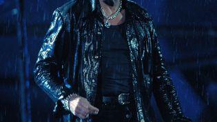 Johnny Hallyday lors du concert au Stade de France, en septembre 1998. (BERTRAND GUAY / AFP)