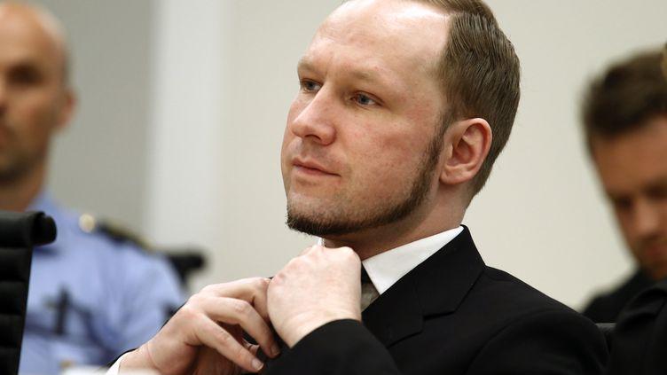 Anders Behring Breivik, lors de son procès pour les attentats d'Oslo et d'Utoya en 2011, le 24 août 2012, à Oslo (Norvège). (HEIKO JUNGE / REUTERS)