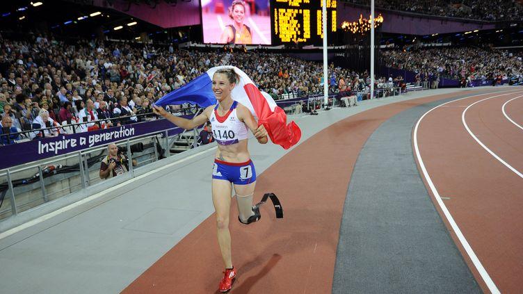 Marie-Amélie Le Fur (gagnante du200 m, le 6 septembre à Londres) a remporté l'une des huit médailles d'or de la France, qui en escomptait seize. (GLYN KIRK / AFP)