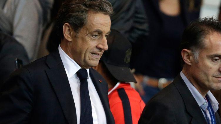 Nicolas Sarkozy au Parc des Princes, le 21 septembre 2014. (KENZO TRIBOUILLARD / AFP)