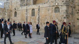 Donald Trump et son épouse Melania, en visite au Saint Sépulcre, à Jérusalem, le 22 mai 2017. (MANDEL NGAN / AFP)