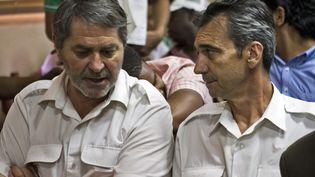 Pascal Fauret (G.)et Bruno Odos, lors de leur procès à Saint-Domingue (République dominicaine), le 27 mars 2013. (ERIKA SANTELICES / AFP)