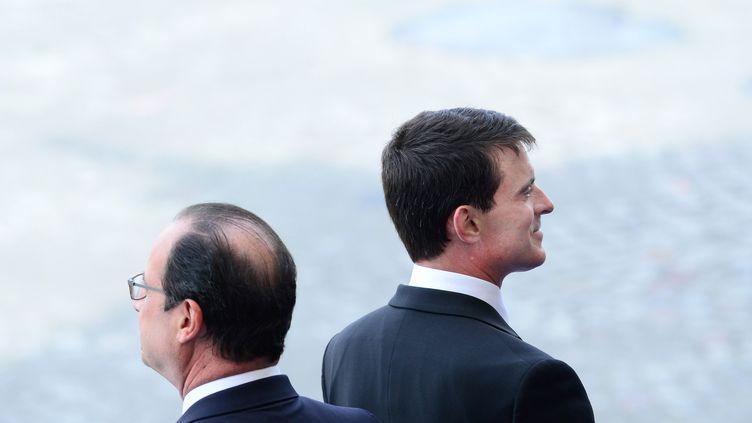 François Hollande et Manuel Valls, le 14 juillet 2014 à Paris. (LCHAM/WITT/SIPA)