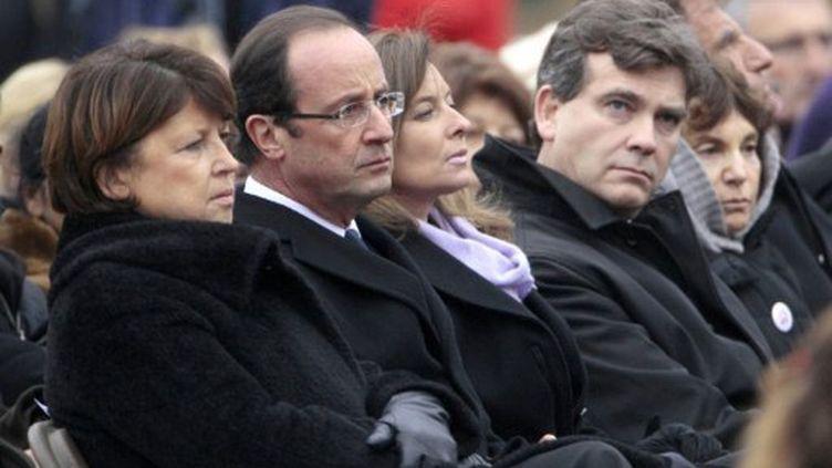 Martine Aubry, François Hollande, sa compagne Valérie Trierweiler et Arnaud Montebourg aux funérailles de Danielle Mitterrand (JACQUES DEMARTHON / AFP)