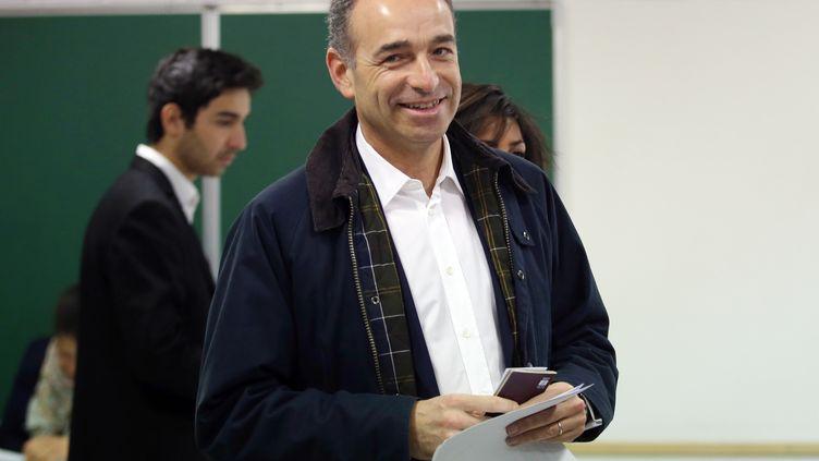 Le président de l'UMP, Jean-François Copé, lors du premier tour des élections municipales, à Meaux (Seine-et-Marne), le dimanche 23 mars 2014. (KENZO TRIBOUILLARD / AFP)