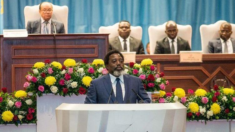 Le président Joseph Kabila à Kinshasa le 19 juillet 2018 (JUNIOR D. KANNAH / AFP)