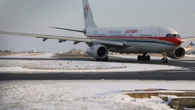 L'aéroport de Roissy sous la neige (18-12-2009) (AFP PHOTO MEHDI FEDOUACH)