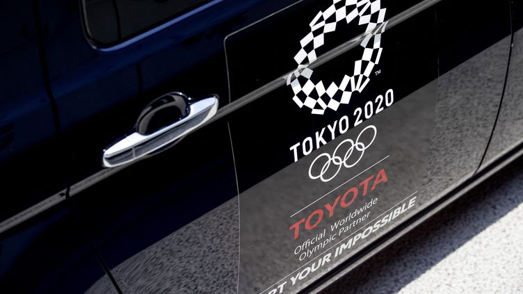 Un taxi olympique officiel de Toyota à Tokyo, le 20 juillet 2021. (KOEN VAN WEEL / AFP)