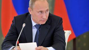 Le président russe, Vladimir Poutine, lors d'une réunion le 26 août 2013 à Kemerovo (Russie). (ALEKSEY NIKOLSKY / RIA NOVOSTI / AFP)