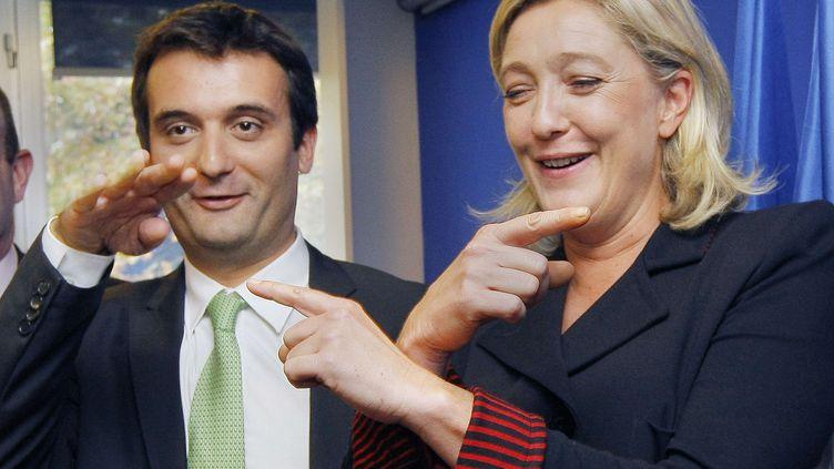 Florian Philippot et Marine Le Pen lors de la présentation de l'équipe de campagne pour les élections présidentielles de 2012, le 6 octobre 2011 à Nanterre (Hauts-de-Seine). (JACQUES BRINON / AP / SIPA)