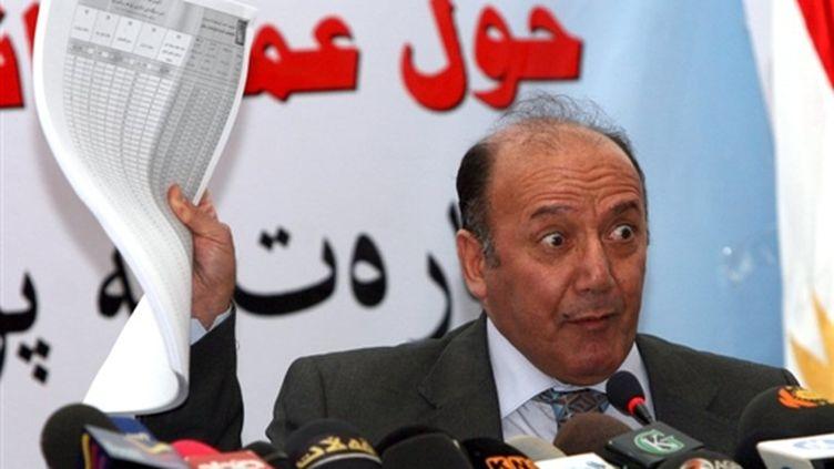 Le chef de la commission électorale, Faraj al-Haïdari (© AFP PHOTO/SAFIN HAMED)