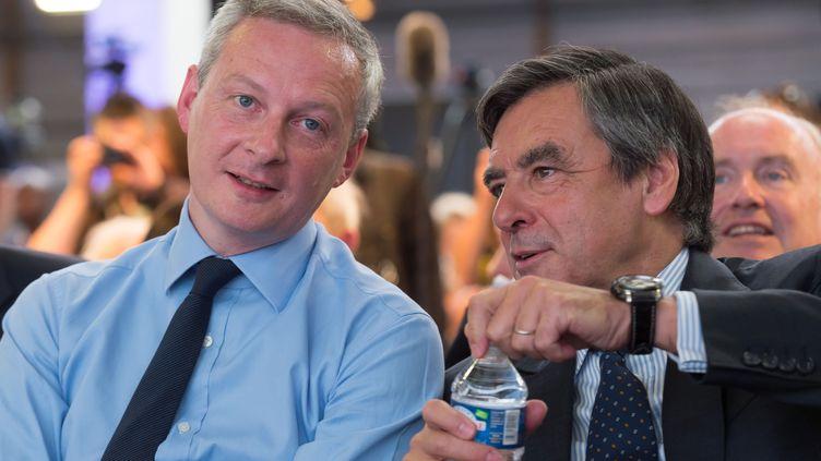 Bruno Le Maire et François Fillon, futurs candidats à la primaire des Républicains, le 30 mai 2015 à Paris lors du congrès fondateur du parti. ( WITT / SIPA)