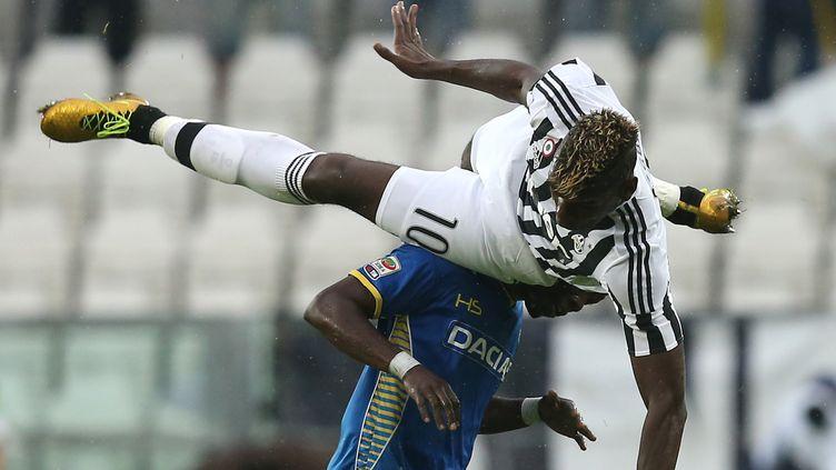 Paul Pogba et les Turinois ont entamé la saison par une défaite (MARCO BERTORELLO / AFP)
