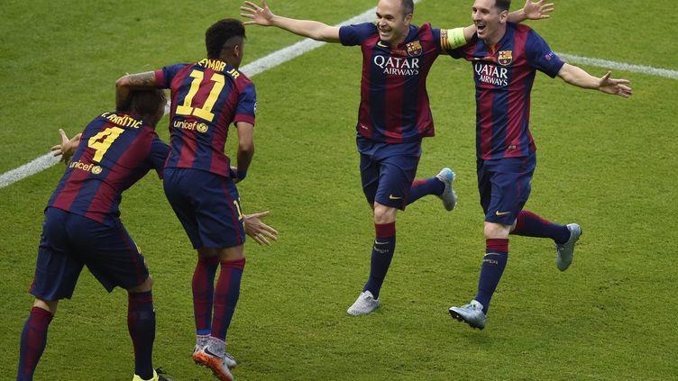 Lionel Messi et ses camarades fêtent un but face à Juventus Turin, lors de la finale de la Ligue des champions, à Berlin (Allemagne), le 6 juin 2015. (ODD ANDERSEN / AFP)