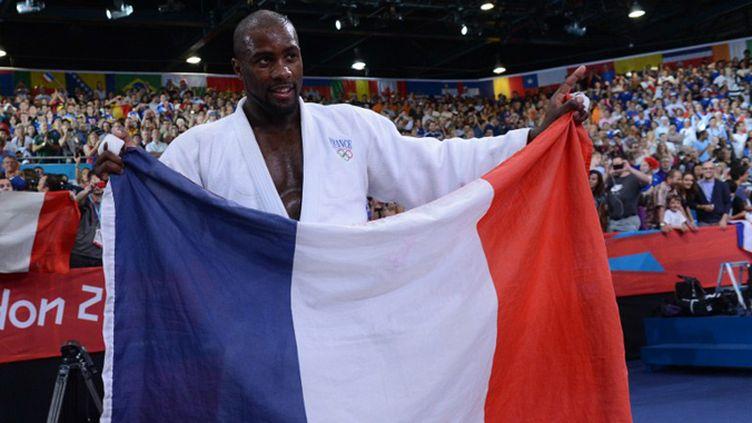 Teddy Riner, champion olympique (EMMANUEL DUNAND / AFP)