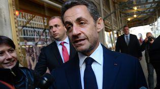 Nicolas Sarkozy lors de son arrivée dans l'hôtel de New York, où il a donné une conférence devant des investisseurs brésiliens, jeudi 11 octobre. (EMMANUEL DUNAND / AFP)