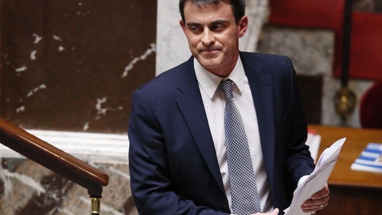 Manuel Valls quitte la tribune de l'Assemblée nationale, après avoir prononcé son discours de politique générale, le 8 avril 2014. (PATRICK KOVARIK / AFP)