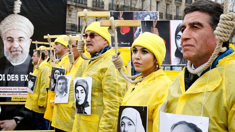 (Manifestation contre les exécutions perpétrées en Iran, ce jeudi à Paris. © Jacky Naegelen/Reuters)