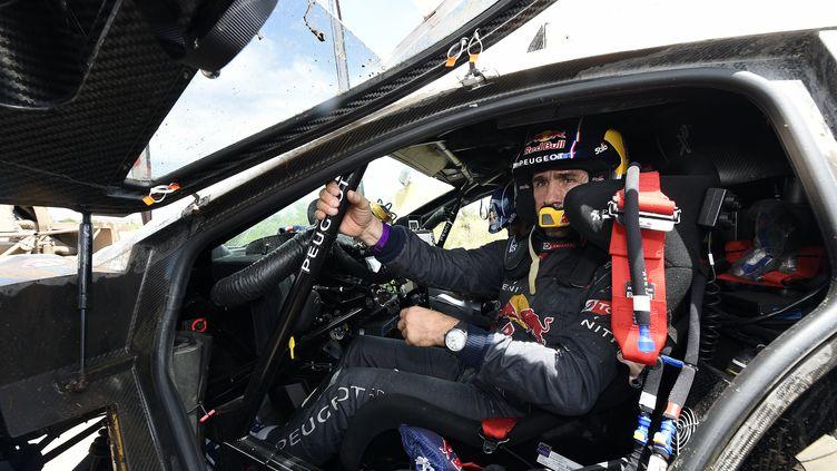 La première place de Stéphane Peterhansel (Peugeot 2008 DKR) est-elle menacée par la plainte de Mini ? (FRANCK FIFE / AFP)