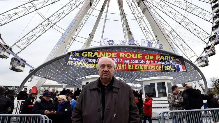 Marcel Campion, le 24 novembre 2016, devant la grande roue de la place de la Concorde, à Paris. (BERTRAND GUAY / AFP)