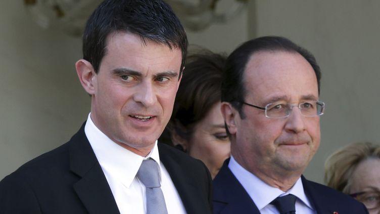 Le Premier ministre, Manuel Valls, aux côtés du président, François Hollande, le 16 avril 2014 à l'Elysée (Paris). ( PHILIPPE WOJAZER / REUTERS)