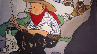 """Image extraite de la couverture originale de """"Tintin en Amérique"""", dessinée en 1932 par Hergé et exposée à la maison Artcurial, à Paris, le 31 mai 2012. (JOEL SAGET / AFP)"""