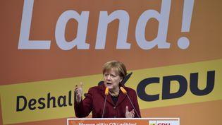 La chancelière allemande, Angela Merkel, tient un discours lors d'un meeting électoral à Haigerloch (Allemagne), le 12 mars 2016. (THOMAS KIENZLE / AFP)