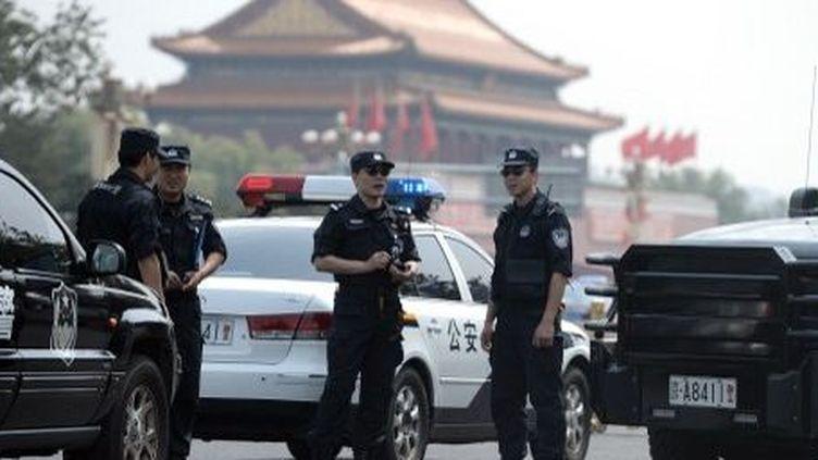APékin, l'accès à la place Tiananmen était strictement controlé par la police, le 4 Juin 2014. (GOH CHAI HIN / AFP)