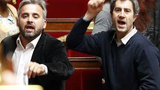 Les députés insoumis Alexis Corbière et François Ruffin à l'Assemblée nationale, le 11 avril 2018. (FRANCOIS GUILLOT / AFP)
