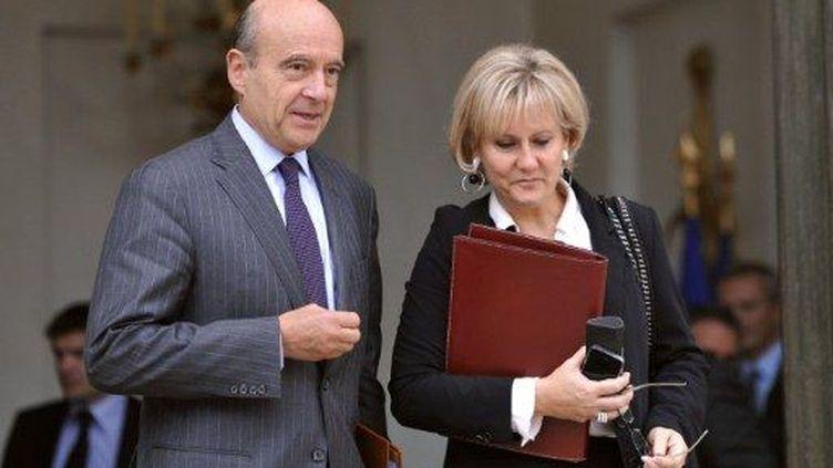 Alain Juppé et Nadine Morano quittent l'Elysée, le 19 octobre 2011. (AFP - Eric Feferberg)
