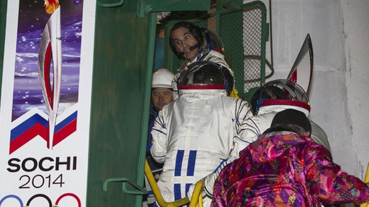 Les spationautes russe Mikhaïl Tiourine, américain Rick Mastracchio et japonais Koichi Wakata ont emmené la flamme dans l'espace (SHAMIL ZHUMATOV / POOL)