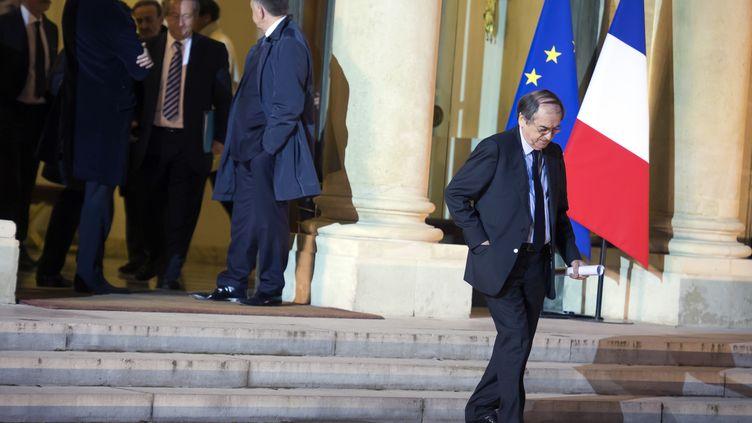 Le président de la FFF, Noël Le Graët, quitte l'Elysée, le 31 octobre 2013 après une réunion avec François Hollande sur la taxe à 75%. (LIONEL BONAVENTURE / AFP)