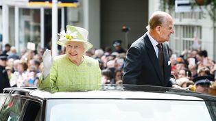 La reine d'Angleterre, Elizabeth II, fête ses 90 ans au côté de son mari le prince Philip à Windsor (Angleterre), le 21 avril 2016. (JOHN STILLWELL / AFP)