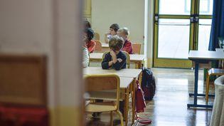 Une classe le jour de la rentrée scolaire, le 2 septembre 2014, à Paris. (FRED DUFOUR / AFP)