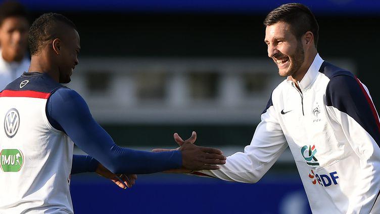 Patrice Evra et André-Pierre Gignac, cette semaine à l'entraînement (FRANCK FIFE / AFP)
