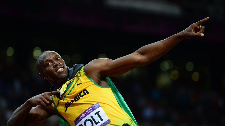 Usain Bolt, après sa victoire au 100 m lors des Jeux olympiques de Londres en 2012. (OLIVIER MORIN / AFP)