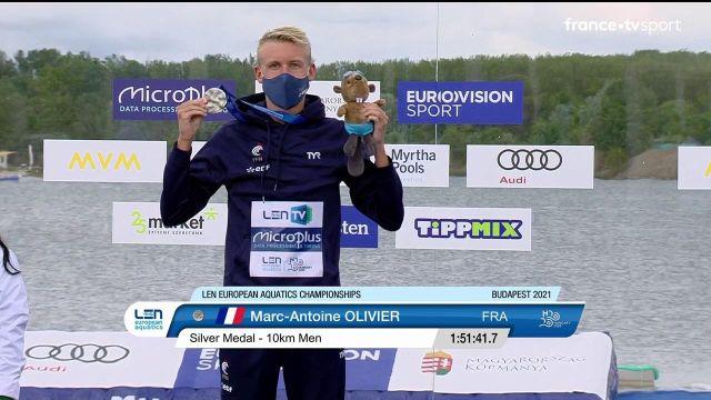 Et de deux ! Marc-Antoine Olivier décroche à nouveau une médaille d'argent, après les 10 km en eau libre des championnats d'Europe. Comme lors des 5km, il est devancé par l'Italien Paltrinieri. La France compte 3 médailles. L'Allemand Wellbrock complète le podium.