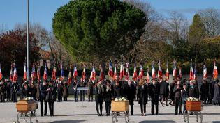 Les obsèques de trois des victimes des attentats qui ont eu lieu dans l'Aude, le 29 mars 2018 à Trèbes (Aude). (ERIC CABANIS / POOL)
