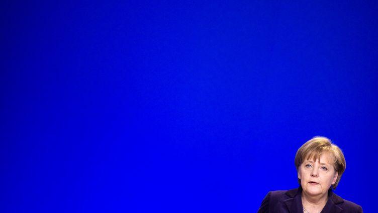 La chancelière allemande Angela Merkel lors d'un conseil européen, le 4 février 2011 à Bruxelles. (LIONEL BONAVENTURE / AFP)