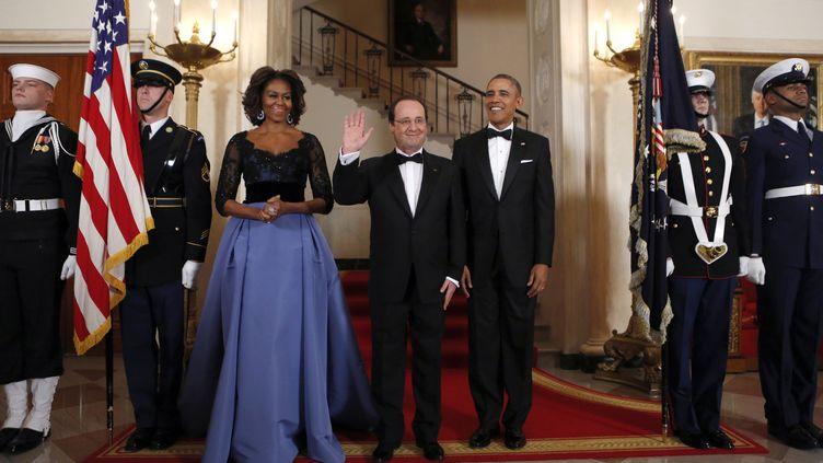 Michelle et Barack Obama accueillent François Hollande, à la Maison Blanche, à Washington (Etats-Unis), le 11 février 2014. (KEVIN LAMARQUE / REUTERS)