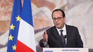 François Hollande, lors de son discours d'inauguration du Musée de l'histoire de l'immigration, à Paris, le 15 décembre 2014. (YOAN VALAT / REUTERS)